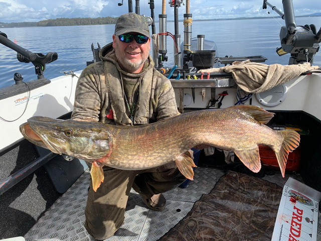 Al Rawlings and Stephen Gibbons with a great pike.